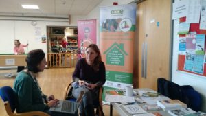 Our director Tara advises a client at our clinic at The Beacon Community Centre.