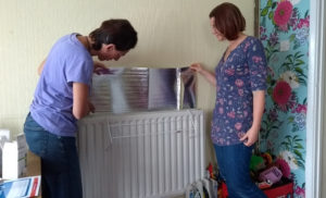 Our chair Tara installs energy saving measures