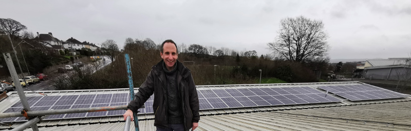 ECOE director and solar PV3 project manager Andy Extance with the installation at The Beacon Community Centre